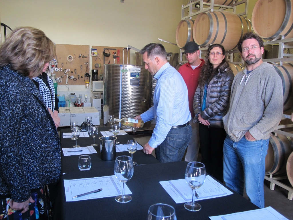 Trevor Allen, Township 7 wine shop manager, assists with pouring
