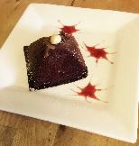 Chocolate and creme brulee pyramid with creme anglaise