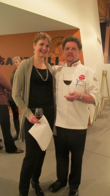 RBuchanan photo - Gold Medal Plates Co-Founder Karen Blair shares a toast with Chef Bernard Casavant, Okanagan College and Judge, at Opening Reception (Local Chair Judy Burns in background)