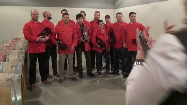 RBuchanan photo - After receiving the mystery wine at the Opening Reception, competing chefs must pause for photos before racing off to plan their dish