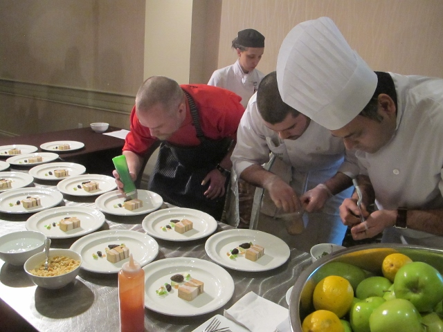 RBuchanan photo - Chef Ryan O`Flynn plating for judges during Grand Finale