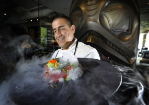 Vancouver  , BC,  July 25,  2012   -- Chef Jefferson Alvarez uses ice creams, sorbets and granitas in the savoury portions of his tasting menus in hot weather.  Here he shows a special tuna dish made with liquid nitrogen, which creates a dramatic cloud of condensation in West Vancouver on  July 25,  2012.   ***pls notesmoke needs to be KEPT in frame!....)     (Mark van Manen/PNG Staff     See   Vancouver Sun Mia Stainsby  Ent. stories  00062938A