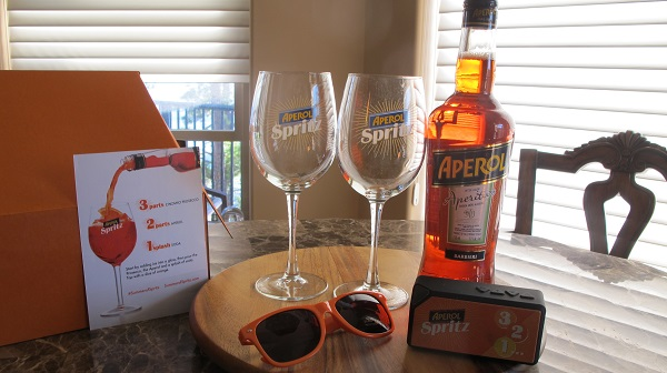 My Aperol Summer of Spritz starter kit including Aperol aperitif, orange sunglasses, recipe card, two logo spritzer glasses and a themed Bluetooth portable speaker