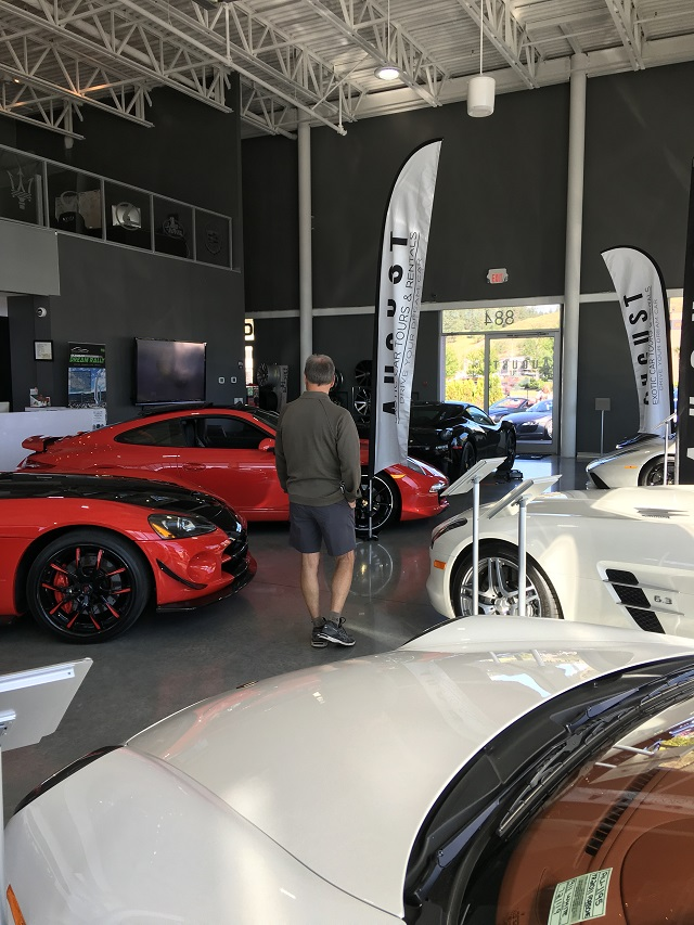 Mark checks out the cars displayed at August Luxury Motorcars