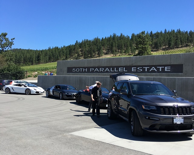 Wine purchases from 50th Parallel are carefully loaded into the Jeep