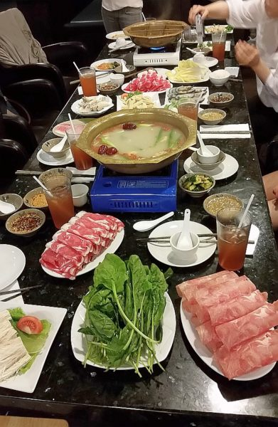 The hotpot table with our ingredients to add to the broth.