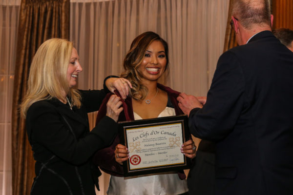 Ms. Melany Bautista (Fairmont Gold Supervisor, Fairmont Hotel Vancouver) (receiving her keys) from Ms. Andrea Torrance - Vice President Operations Support, Americas, for Fairmont Hotels & Resorts & Mr. Darren Klingbeil, Fairmont Gold Manager, Fairmont Hotel Vancouver