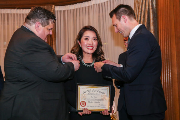 Ms. Sue Yoon recieving keys from Mr. Don Mooney- right , Vice Director of Les Clefs d'Or Canada and Mr. Brad Simmons, Director of Sales and Marketing, Rosewood Hotel Georgia.