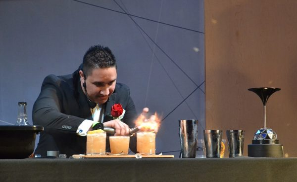 Cocktail Competition winner Matt Benevoli playing with fire - photo by Cathy Browne