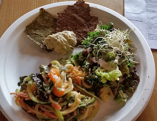 Eternal Abundance flax crackers with sunflower cheeze, Kale Caesar Salad, and Zucchini Pad Thai