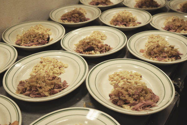 The main course at Save-On Meats -Choucroute Garnie – smoked sausage + Reisling fermented cabbage + Spaetzle + brown butter cream. Photo courtesy of the French Consulate