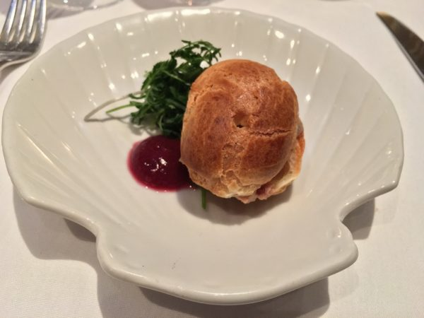 Our first perfect bite at Bistro Pastis - a Foie Gras Parfait Profiterole. Photo by Cathy Browne