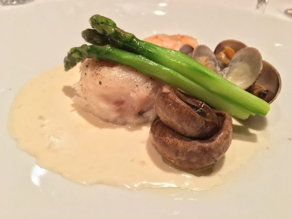 The Sole Normande featured a perfectly cooked filet on a cream sauce with a seafood medley, button mushrooms and asparagus spears - photo by Cathy Browne