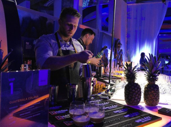 Former World Class Canada winner Grant Sceney pouring signature cocktails in the Science of Cocktails VIP Lounge. Photo by Cathy Browne.